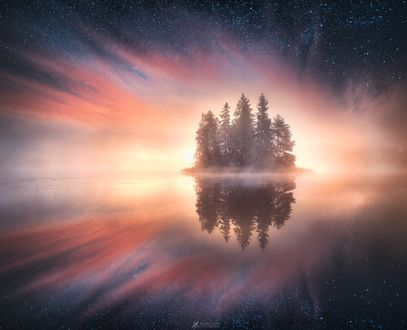 Обои Островок с деревьями в окружении воды, фотограф Lauri Lohi