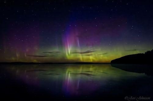 Обои Ночное красивое небо над водой, фотограф Jari Johnsson
