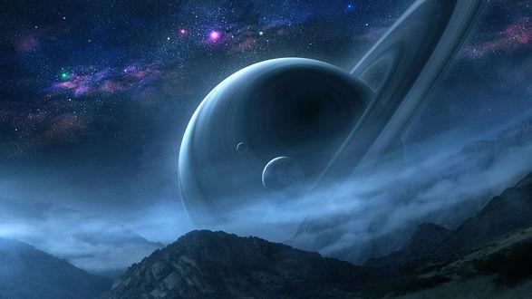 Обои Сатурн над горами на фоне космоса