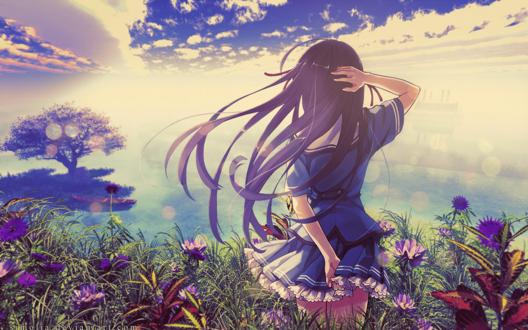 Обои Длинноволосая девушка стоит в траве среди цветов и смотрит на море
