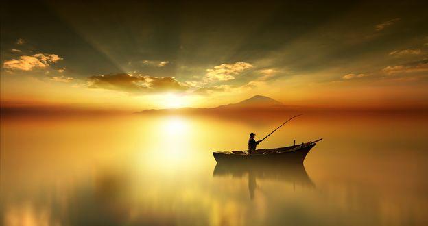 Обои Рыбак в лодке на фоне заката, фотограф Anna Ovatta