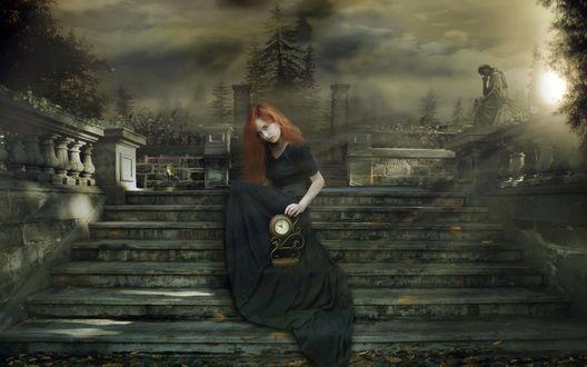 Обои Девушка с рыжими волосами и в черном платье сидит на лестнице, ведущей к кладбищу, позади кладбище, размытое в лучах луны, пробивающейся сквозь тучи