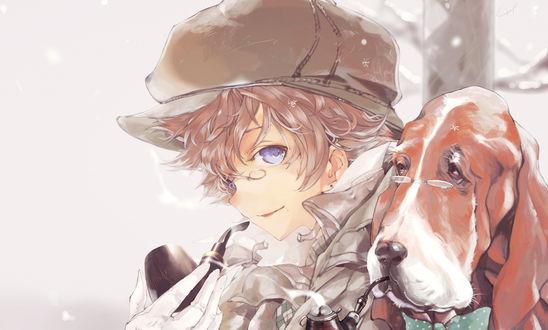 Обои Мальчик в кепочке сидит рядом с собакой
