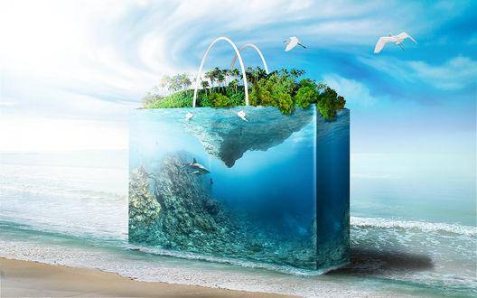 Обои Прозрачная сумка-аквариум, где в глубине скользит среди скал акула, а на поверхности воды расположился поросший зеленью островок, на фоне волн прибоя и чаек