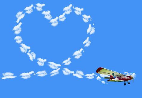 Обои Самолет, нарисовавший в синем небе сердце, поздравительная открытка