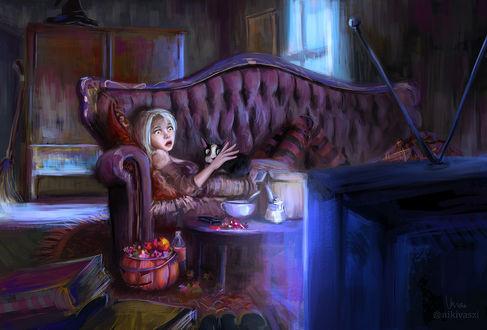 Обои Девочка с котом лежит на диване и смотрит телевизор