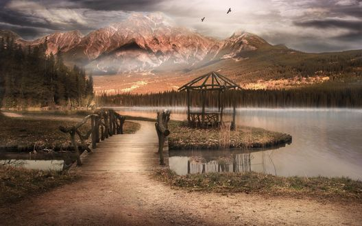 Обои Мост через реку, ведущий к небольшой беседке на берегу