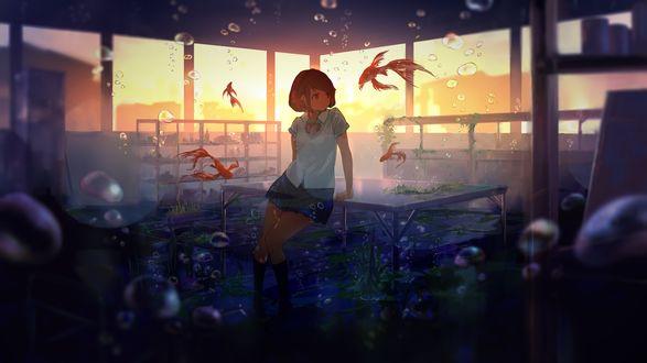 Обои Девочка-школьница стоит у стола в окружении рыбок