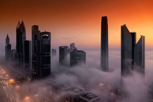 Обои Небоскребы города Дубай в утреннем тумане в ОАЭ (Dubai, AUE)
