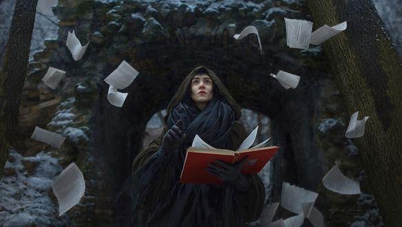 Обои Девушка в образе колдуньи с книгой в руке и летающих вокруг нее страниц, фотограф Irina Dzhul