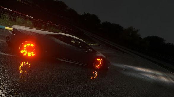 Обои Машина со светящимися покрышками на дороге ночью