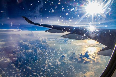 Обои Облачное небо, вид с иллюминатора, фотограф