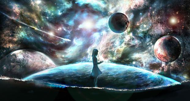 Обои Девушка стоит в окружении планет