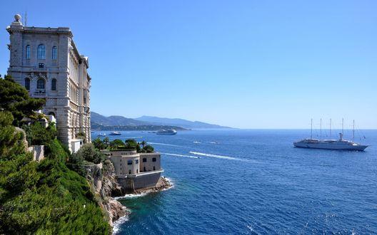 Обои Небольшая каменная башня на берегу моря в ясную погоду, вдали виднеется яхта в море, Monaco, Monte Carlo / Монако, Монте-Карло, by Igor Shiko