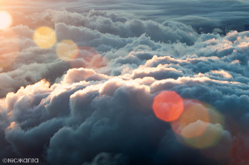Обои Облака в свете боке, фотограф Nick