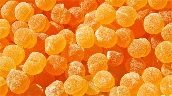 Обои Россыпь апельсинового мармелада в сахаре