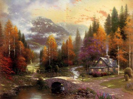 Обои Домик у реки в лесу среди деревьев на фоне заснеженной горы осенью. Мост и дорожка. Art Thomas Kinkade