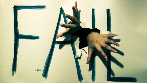 Обои Руки просящие помощи проникают через разорванный картон, на котором написано Fall / Падение