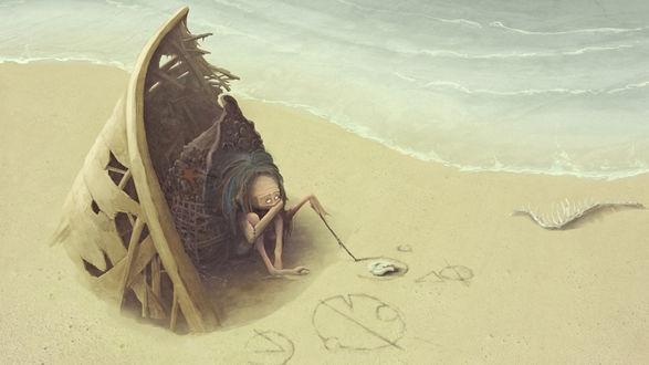 Обои Человечек на берегу моря сидит в ракушке и рисует знаки