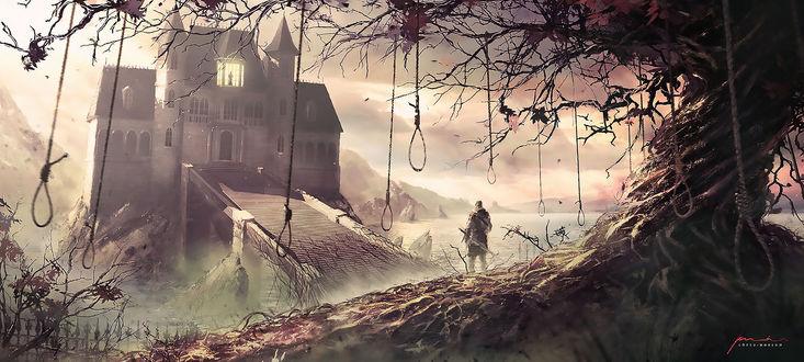 Обои Мужчина-воин стоит у дороги, ведущей к замку, возле дерева с виселицами