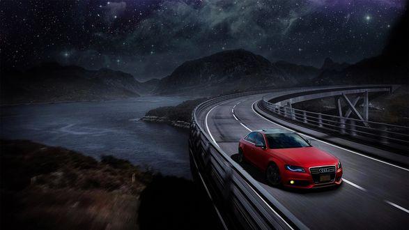 Обои Красный Audi едет по дороге, на заднем плане горная река под звездным небом