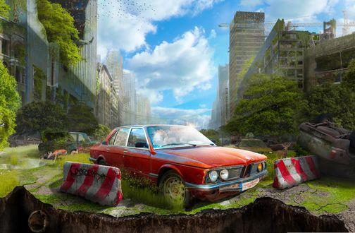 Обои Красная машина стоит над разверзшейся пропастью, а позади нее раскинулся заброшенный город, с домами, поросшими деревьями и травой под ярко-голубым небом с белыми тучками