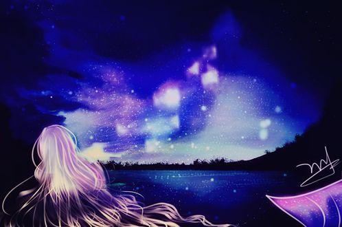 Обои Русалка у воды на фоне ночного неба