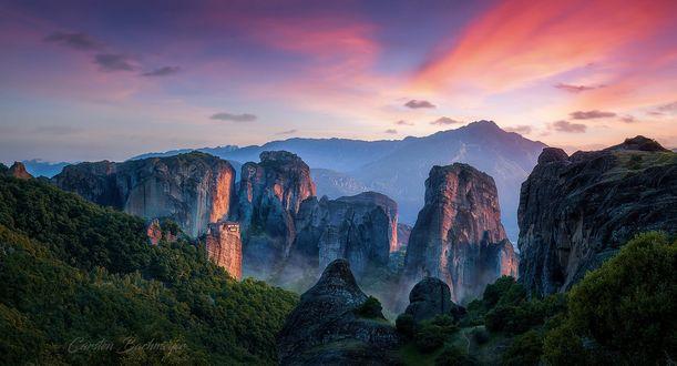Обои Скалы под облачным небом, фотограф carsten bachmeyer