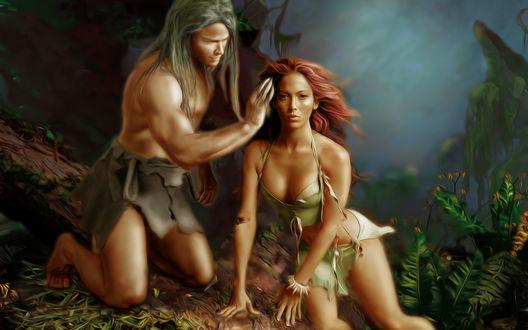 Обои Тарзан гладит по голове рыжеволосую девушку