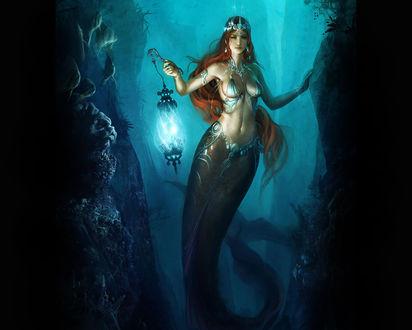 Обои Девушка-русалка с фонарем в ущелье под водой
