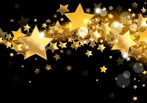 Обои Золотистые звезды и блики на черном фоне