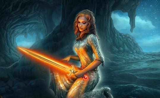 Обои Девушка с мечом, источающим огненный свет, присела на колено в пещере, by Kerem Beyit