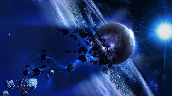 Обои Планета, окруженная обломками метеорита, на фоне сияния звезды
