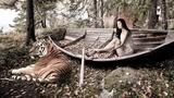 Обои Девушка в лодке и рядом лежит тигр
