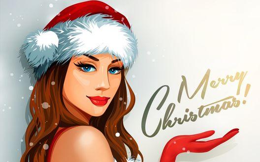 Обои Девушка в новогодней шапочке держит руку под словами (Merry Christmas! / Веселого Рождества!)