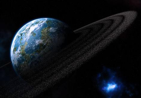 Обои Земля, окруженная астероидным поясом, в космическом пространстве
