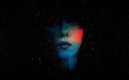 Обои Лицо девушки на фоне космического пространства