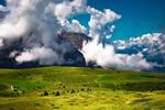 Обои Горы в белых облаках перед долиной с домиками и коровами на пастбище, by sardegna orange