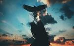 Обои Черная птица вылетает из головы девушки в черном платье на фоне черных облаков