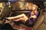 Обои Актриса Laura Dianne Vandervoort / Лора Дайанн Вандерворт сидит на заднем сидении Audi / Ауди