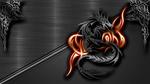 Обои Фигура дракона в огне на металлической поверхности