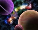Обои Планеты на фоне разноцветной туманности в космосе