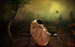 Обои Грустная девушка сидит на лавочке под падающей осенней листвой
