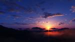 Обои Закат солнца над вершинами гор