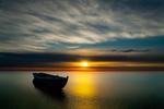 Обои Дрейфующая лодка на закате, фотограф Tore H