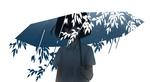 Обои Девушка с зонтом, из которого выглядывают ветки с листочками