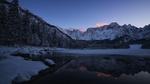 Обои Небольшое озеро в окружении зимнего леса и гора Мангарт, Laghi di Fusine / Лаги ди Фусине, Италия, Italy, by Federico Bottos