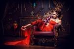 Обои Девушка в красном позирует, сидя на кожаном кресле, в комнате, с интерьером в стиле ретро, фотограф Kiselev Andrey Valerevich