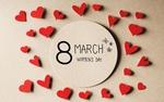 Обои Сердечки лежат вокруг светлой дощечки с фразой 8 March, Womans Day / 8 марта, Международный женский день на ней