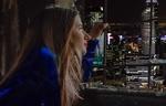 Обои Девушка со светящимися глазами, сидя у окна, любуется видом ночного города, by Reinhardi